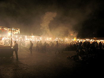 English: Steam rises from food stalls in the J...