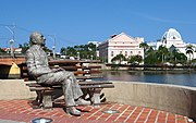 João Cabral de Melo Neto statue, an important writer of Recife. Behind, Santa Isabel Theatre.