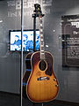 "John Lennon's missing 1962 Gibson J-160E guitar in the exhibit (clip2) - ""Ladies and Gentlemen... the Beatles!"" exhibit at LBJ Presidential Library, Austin, TX, 2015-06-10 10.42.09.jpg"