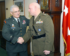 New York State Executive Department - Major General Robert Wolf (right) is congratulated by Major General Joseph Taluto (left) following Wolf's promotion in the New York Naval Militia.