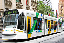 A D1 class tram on route 6 in front of Melbourne Town Hall, Swanston Street.