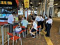 KMB staff in Tuen Mun Station help passengers to take Route 56S 10-10-2020.jpg