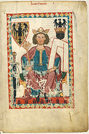 A young bearded man sitting on a throne