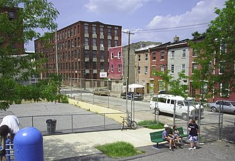 Kensington, Philadelphia - Playground in the neighborhood of Kensington, Philadelphia. Note the factories in the background, one of which has been recently converted into the Coral Street Arts House, low-income housing for artists.