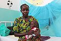 Kenyan mother with child at a hospital in Lodwar, Kenya.jpg