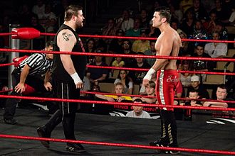 Eddie Edwards (wrestler) - During his feud with El Generico and Kevin Steen (left) over the ROH World Tag Team Championship in 2009, Edwards broke his elbow