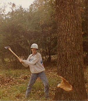 Aggie Bonfire - Student felling a tree for Bonfire