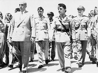 Ali Abu Nuwar - Abu Nowar, as Chief of Staff, walking between Hussein and Syrian president Shukri al-Quwatli in late 1956
