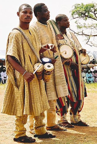 Talking drum - Yoruba drummers: The nearest holds omele ako and batá, the other two hold dunduns.