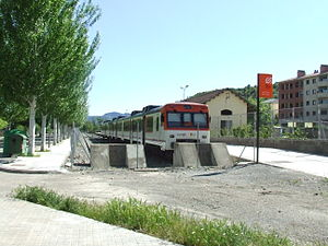 Lleida–La Pobla Line - A Renfe Operadora 592 Series train at La Pobla de Segur station in 2009.