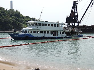 2012 Lamma Island ferry collision - The crippled Lamma IV, on a beach at Nga Kau Wan on the Lamma Island after the accident.