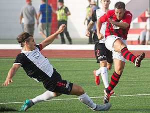 Lee Casciaro - Casciaro (right) with Lincoln Red Imps during UEFA Champions League match against FC Midtjylland