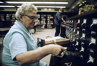 School library - School librarian with card files (Minnesota, 1974)