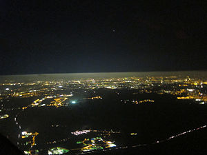 Planetary boundary layer - The difference in the amount of aerosols below and above the boundary layer is easy to see in this aerial photograph. Light pollution from the city of Berlin is strongly scattered below the layer, but above the layer it mostly propagates out into space.