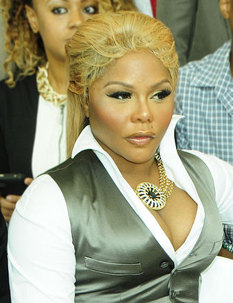 "American rapper and singer Lil' Kim is known as the ""Queen Bee"". Lil Kim Mercedes Benz Fashion Week 2012 (modified).jpg"