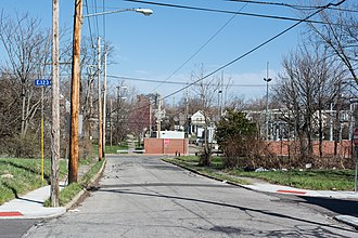 """Glenville shootout - View of Beulah Avenue. The photographer was standing about where the abandoned vehicle was. The intersection in the distance is Beulah and Lakeview, where the four gunmen stood and suspect Leroy Harrison died. A power substation stands where 1391 and 1395 Lakeview once stood. The """"alley"""" down which the gunmen fled is still visible."""