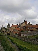 Looking up Borough Beck to the higgledy-piggledy buildings of Helmsley - geograph.org.uk - 432528.jpg