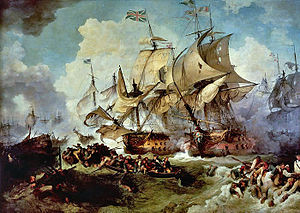 Two large ships sail side by side locked in battle as heavy brown seas roll beneath them and clouds of smoke from other vessels in the background drift into frame. In the foregound, dozens of men cling to wreckage in the water or drift in small boats.