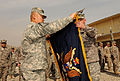 Lt. Col. Michael Loos unveils the unit flag (4370358199).jpg