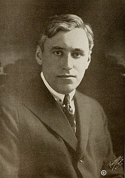 Black and white portrait photograph of Mack Sennett in 1916. He is dressed in a jacket, shirt and tie and is looking into the camera.