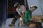 Maintenance on Hornet in the hangar bay DVIDS99909.jpg