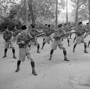 Songkok - Men of the Royal Malay Regiment (Rejimen Askar Melayu DiRaja) wearing songkok at bayonet practice, Singapore Island (1941).