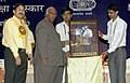 Mallikarjun Kharge releasing the Poster 'Protect yourself from welding rays', at the Vishwakarma Rashtriya Puruskars and National Safety Awards presentation ceremony, in New Delhi on September 17, 2012.jpg