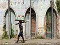 Man Carries Items before Ruined Facade - Cachoeira - Bahia - Brazil.JPG