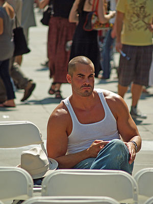"Sleeveless shirt - A man wearing a tank top, also known as an ""A-shirt"" in some countries."
