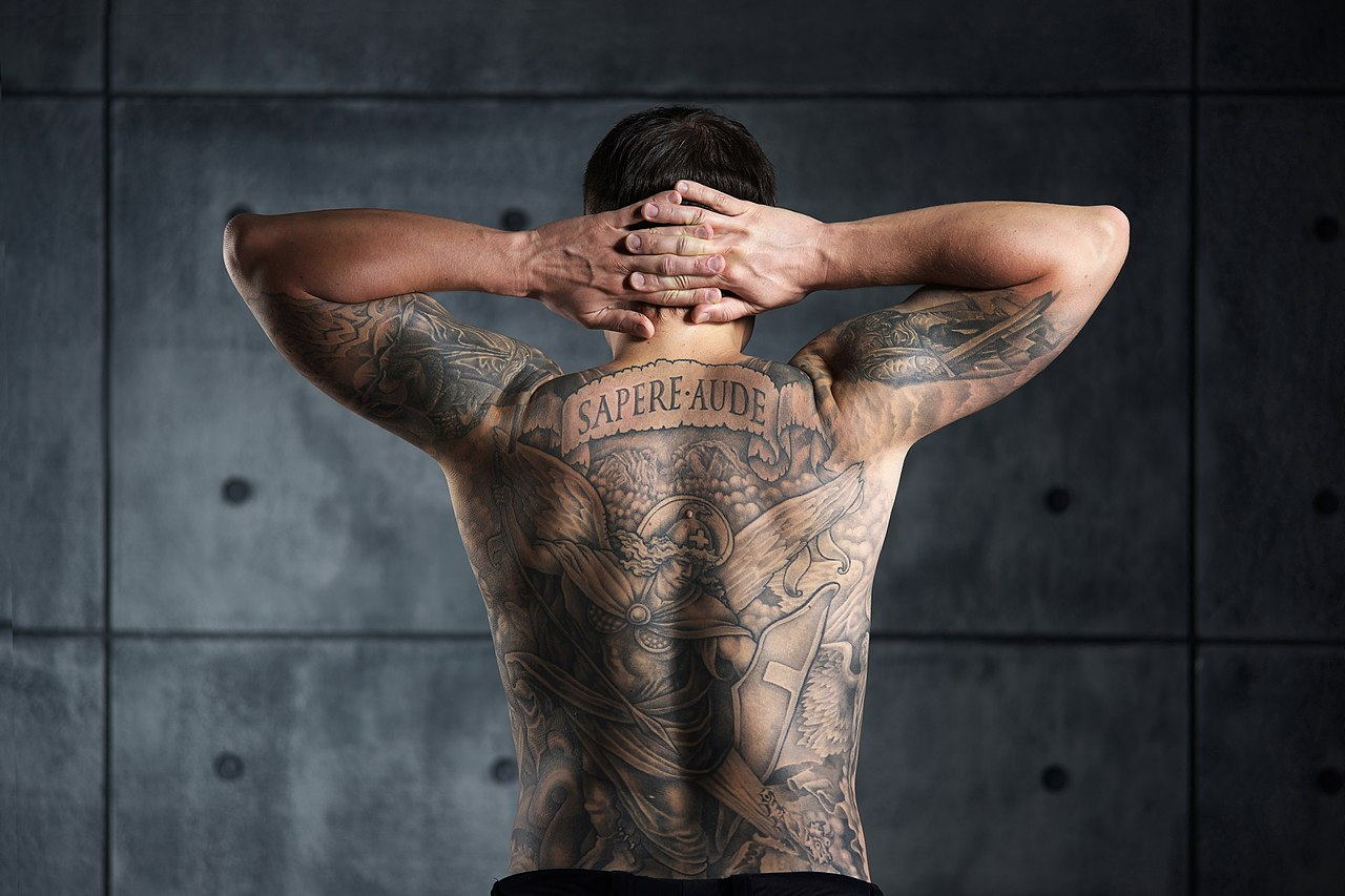 File:Man with a backpiece Christian and Enlightenment tattoo. Color ...