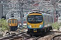 Manchester Victoria - TPE 185115 and Arriva 319383.JPG