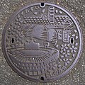 Manhole cover in Nishinomiya; April 2005 (02).jpg