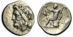 Megalopolis, Greece - A silver drachm of the Arcadian League from ancient Megalopolis. The head of Zeus on the obverse, Pan seated on the reverse.