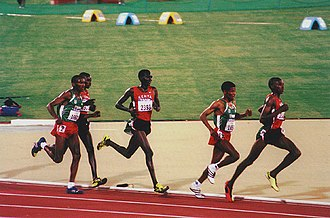 Haile Gebrselassie - Haile (second, in green) on the way to becoming two-time 10,000 m Olympic champion in Sydney