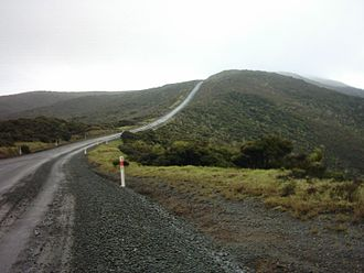 Cape Reinga - The former metal road (actually State Highway 1) to Cape Reinga / Te Rerenga Wairua in 2005, sealing being finished in 2010. 'Metal road' is a local term for a gravel road.