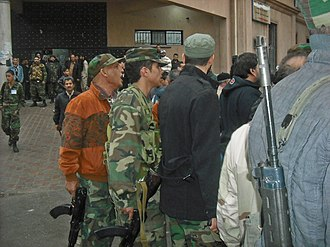 Factional violence in Libya (2011–14) - Militiamen in the streets of Tripoli after skirmishes, January 2012. Since the end of the 2011 Libyan Civil War, armed militias had clashed throughout the country.