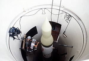 Missile launch facility - U.S. Minuteman II missile being worked on, in its underground silo launch facility