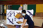 Misawa Air Base volunteers sort Operation Airlift Japan items DVIDS419448.jpg