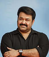 Photograph of Mohanlal in a black T-shirt