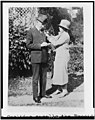 Mrs. Calvin Coolidge enrolls the President in the American Red Cross LCCN94509222.jpg