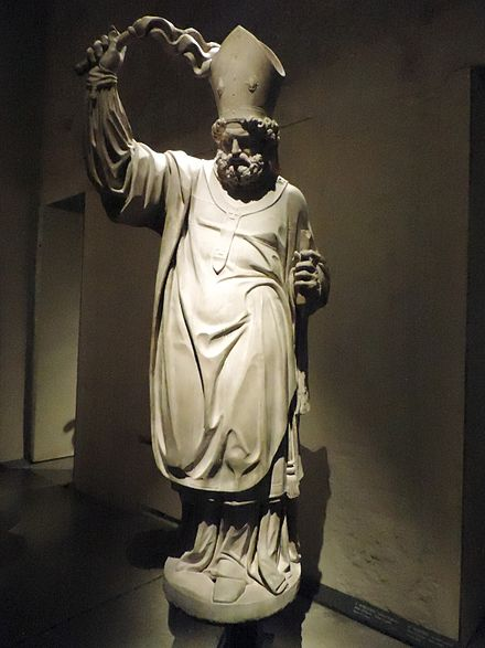 Statue of Saint Ambrose with a scourge in Museo del Duomo, Milan. Unknown Lombard author, early 17 century. Museo del Duomo - Milan - St Ambrose of Milan - Unknown Lombard author (early 17 century).jpg
