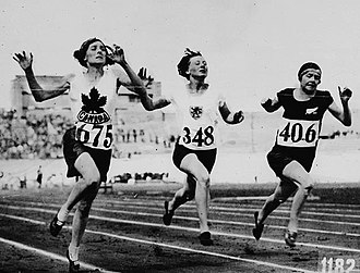 Myrtle Cook - Image: Myrtle Cook of Canada (left) winning a preliminary heat in the womens 100 metres race at the VII Ith Summer Olympic Games
