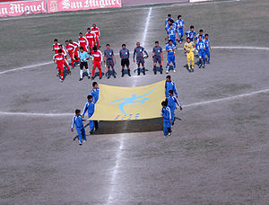 Nepal Police Club - Player of Nepal Police Club (Red Jersey),While playing against Three Star Club(Blue Jersey)