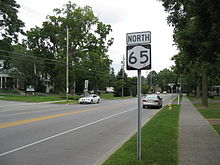 NY 65 and a shield in residential Honeoye Falls