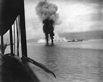 Naval Battle of Guadalcanal - Smoke rises from two Japanese aircraft