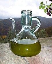 https://upload.wikimedia.org/wikipedia/commons/thumb/c/cb/New_olive_oil%2C_just_pressed.jpg/180px-New_olive_oil%2C_just_pressed.jpg