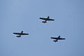 North American AT-6 SNJ Texan Trio Overhead 01 SNFSI FOF 15April2010 (14607336876).jpg