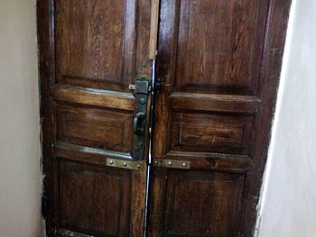 Old door at the entrance to the library of Kha...