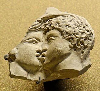 Tarsus, Mersin - Oscillum depicting a couple kissing. Terracotta figurine made in Tarsus, Roman Era