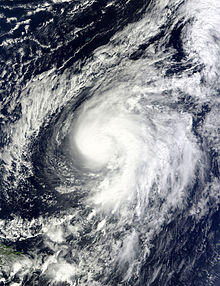 A satellite image showing a minimal hurricane in the central Atlantic.